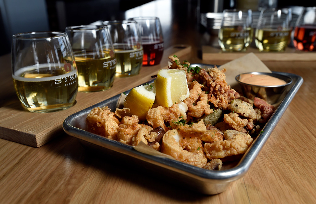. Point Judith calamari with olives and piquillo peppers at Acreage by Stem Ciders restaurant on Thursday in Lafayette. For more photos of the restuarant and the food go to dailycamera.com Jeremy Papasso/ Staff Photographer 04/12/2018