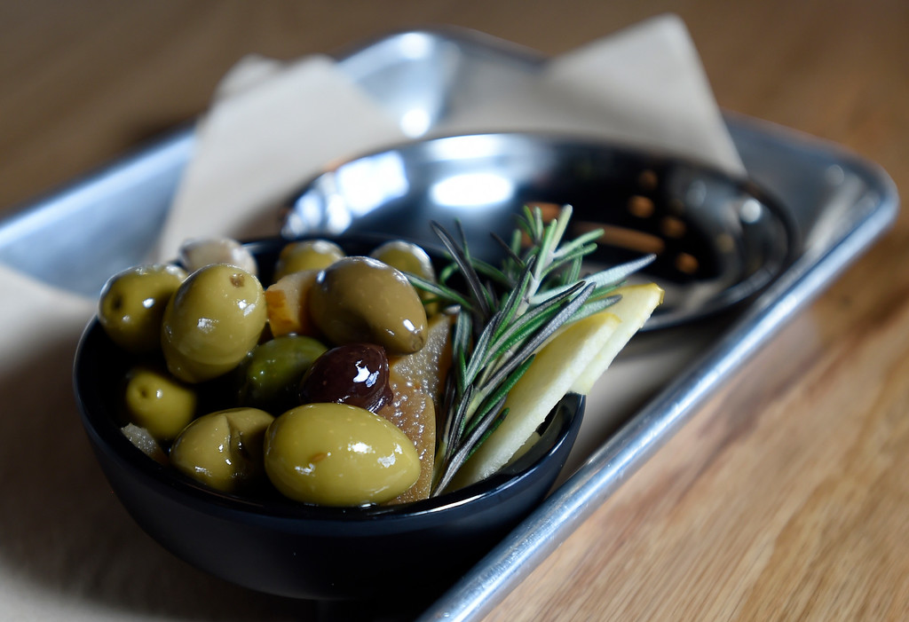 . A mix of spanish olives with toasted cumin and rosemary at Acreage by Stem Ciders restaurant on Thursday in Lafayette. For more photos of the restuarant and the food go to dailycamera.com Jeremy Papasso/ Staff Photographer 04/12/2018
