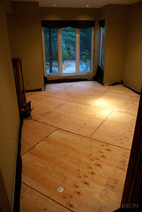 "The floating subfloor consists of two layers of 1/2"" plywood, with 1/2""-3/4"" gaps between sheets to allow for expansion. One layer is laid in at a 45° angle to increase the overall dimensional stability of the subfloor, making it the top layer avoids any issues with expansion gaps potentially lining up with the flooring. the layers are screwed together with 3/4"" wood screws every 18"" or so."