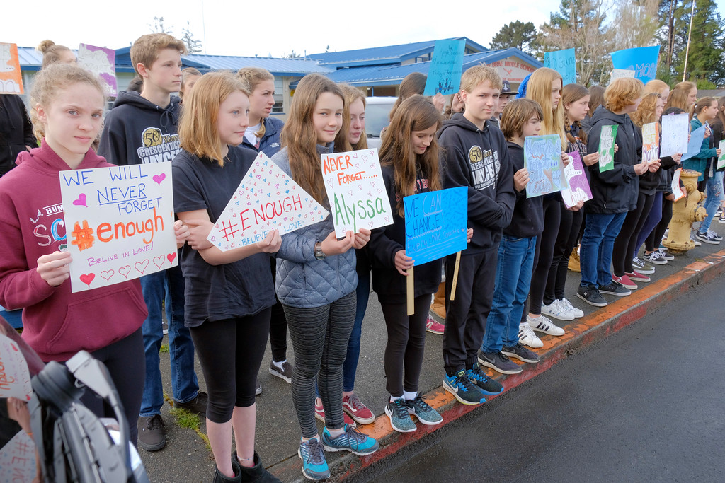 . Shaun Walker � The Times-Standard  Sunny Brae Middle School students and several staff members stand in front of the Arcata school Wednesday morning in silent remembrance of the latest Florida school shooting victims and calling for gun law reforms.Shaun Walker � The Times-Standard  Sunny Brae Middle School students and several staff members stand in front of the Arcata school Wednesday morning in silent remembrance of the latest Florida school shooting victims and calling for changes that will help prevent more similar events.