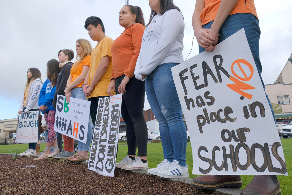 . Shaun Walker � The Times-Standard  Arcata High School students and gather in the Arcata Plaza on Wednesday morning in silent remembrance of the latest Florida school shooting victims after a bit was read about each one killed, some calling for stricter gun control.