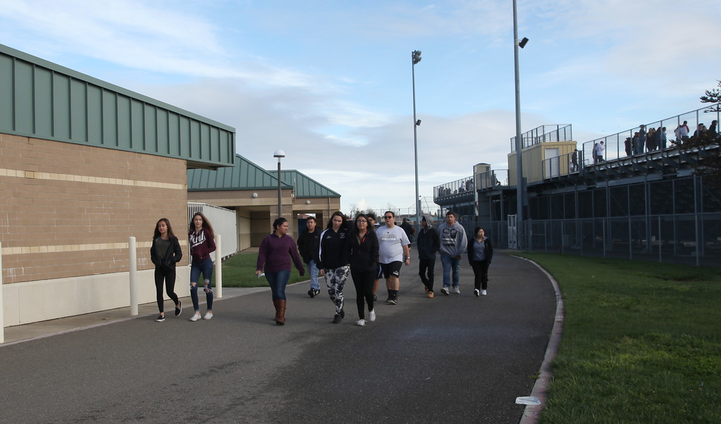 . Students at Pioneer High School wait to enter the football field. At 10 a.m. they exited their classrooms in protest of gun violence during a nationwide school walkout. CINTIA LOPEZ -- WOODLAND DAILY DEMOCRAT