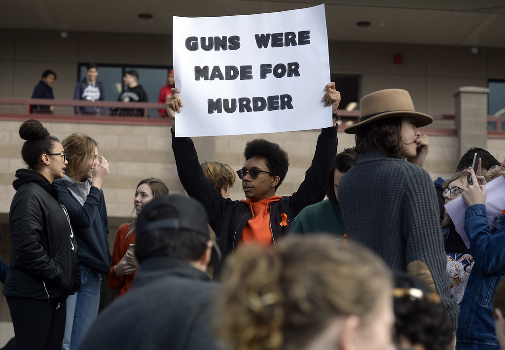 . Brandyn Silva, 17 a senior at Vacaville High School holds  a sign protesting gun violence  while taking part in the National School Walkout Wednesday in the quad in front of the English building. Joel Rosenbaum -- The Reporter