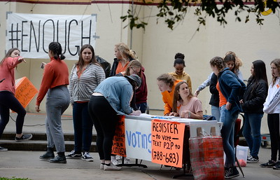 Chico High School students participate in the National Walkout Wednesda. CHS Junior Emily Hull at table talks to others a voting pre-registration table where students 16-years or older are allowed to pre-register to vote Wed. March 14, 2018.  (Bill Husa -- Enterprise-Record)