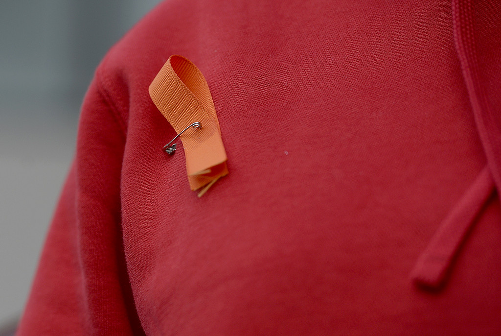 . Vacaville High School students wore orange ribbons to honor the memory of the 17 people killed at Stoneman Douglas High School last month as they participate in the National School Walkout Wednesday in the quad in front of the school\'s English building. Joel Rosenbaum -- The Reporter