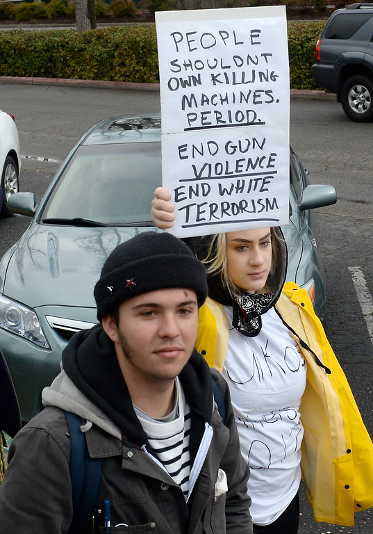 . Students from several schools including CSUC and Inspire School of the Arts participate in the National Walkout to end school violence by walking down The Esplanade and through downtown holding signs Wed. March 14, 2018.  (Bill Husa -- Enterprise-Record)