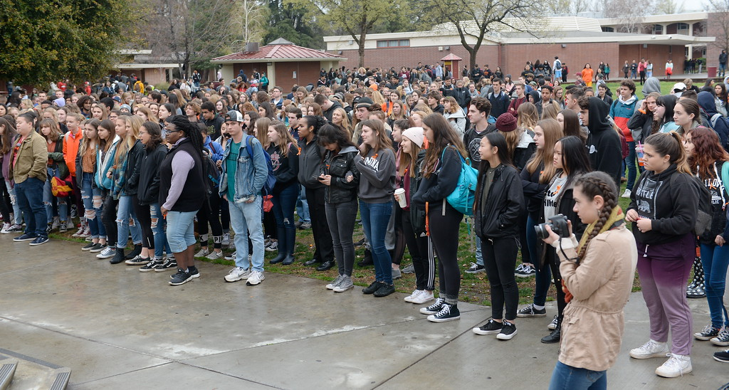 . Chico High School students participate in the National Walkout to end school violence by honoring those killed with a moment of silence and a handfull of students spoke on the subject. Students also posted banners and set up a voting pre-registration table where students 16-years or older are allowed to pre-register to vote Wed. March 14, 2018.  (Bill Husa -- Enterprise-Record)