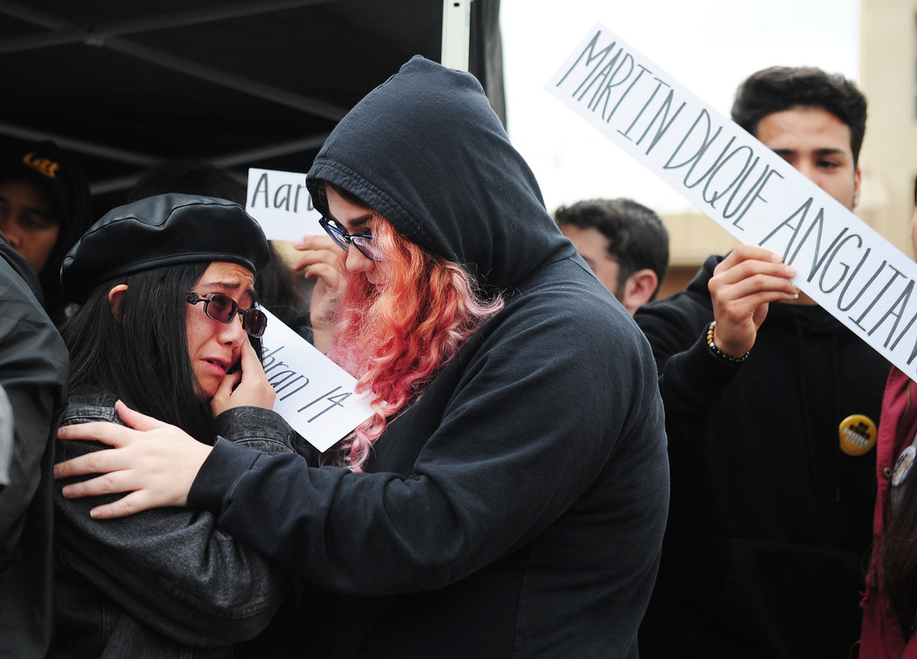 . VALLEJO, CA - MARCH 15, Robbin Balagtas is comforted by Jordyn Casner as Balagtas gets emotional after speaking during the nation-wide student and teacher walk out to remember the 17 victims of the Parkland School shooting. (CHRIS RILEY/TIMES-HERALD)