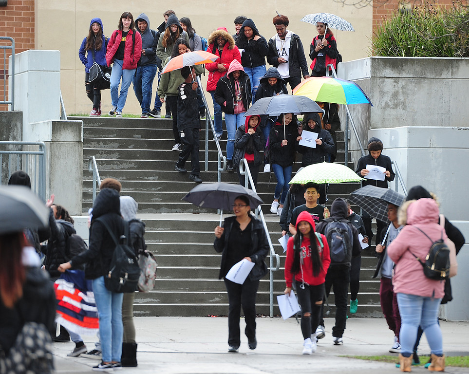 . VALLEJO, CA - MARCH 15, Students at Jesse Bethel High School carry signs to protest gun violence during a nation-wide walk out to remember the 17 victims of the school shooting in Parkland, Florida. (CHRIS RILEY/TIMES-HERALD)