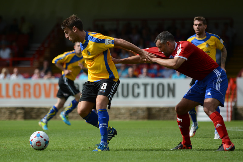 Simon Richman of Altrincham is well marshalled by Aldershot's Chris Barker