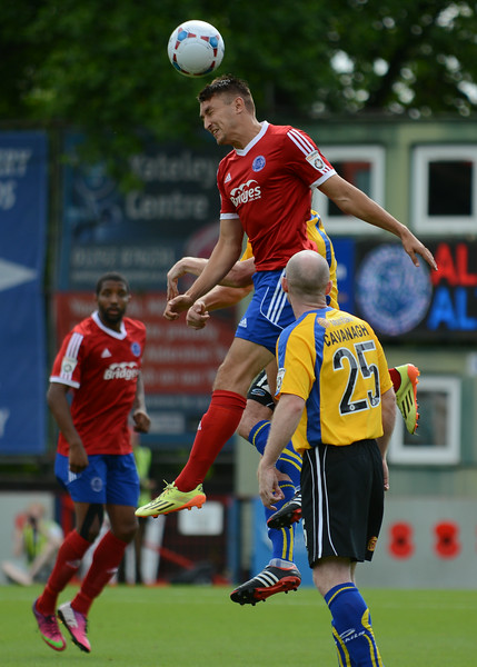 Aldershot's Brett Williams rises highest to win this header