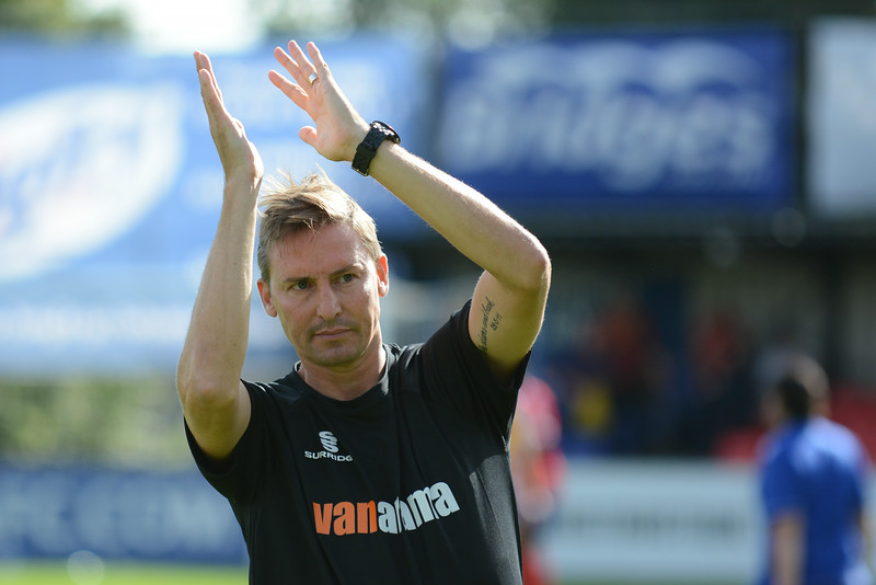 Andy Scott applauds the fans at the final whistle