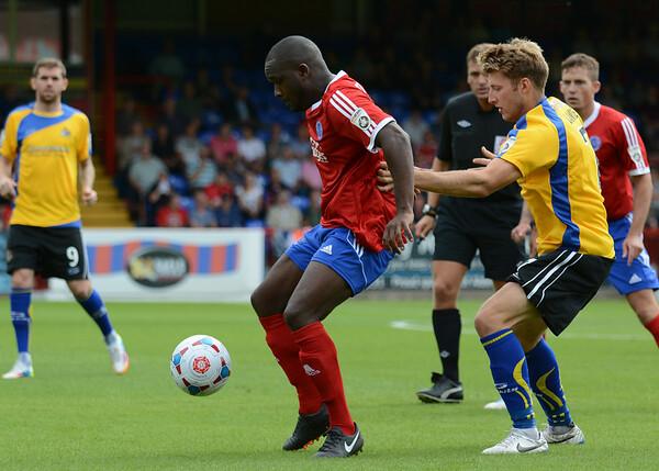 Kieron Forbes of Aldershot holds off Altrincham's James Lawrie
