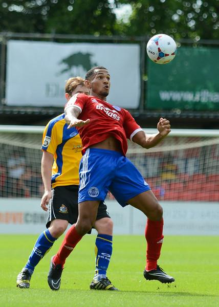 Jordan Roberts controls the ball