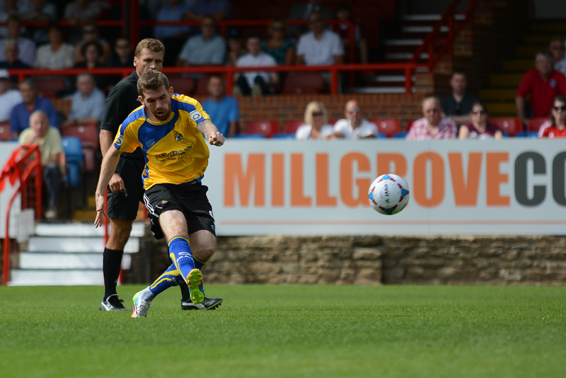Altrincham's Steven Gillespie tries a shot from long range