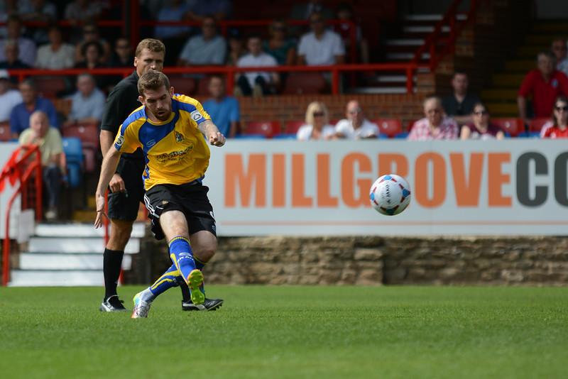 Altrincham's Steven Gillespie tries a shot from long range