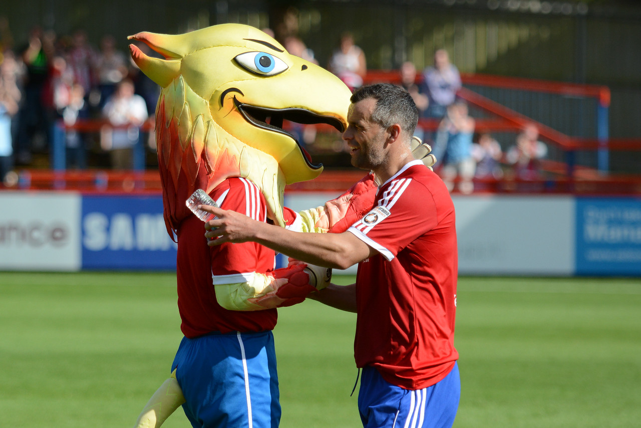 Chris Barker is congratulated by the mascot