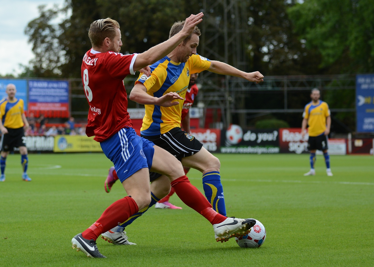 Altrincham's Nicholas Clee cant find a way past the Aldershot defence