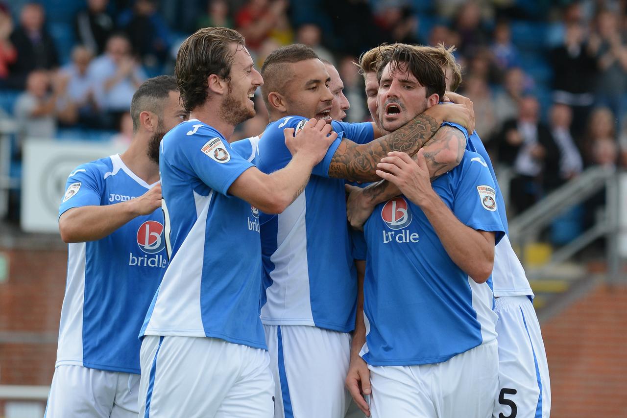 Ben Strevens and his team mates celebrate the equaliser
