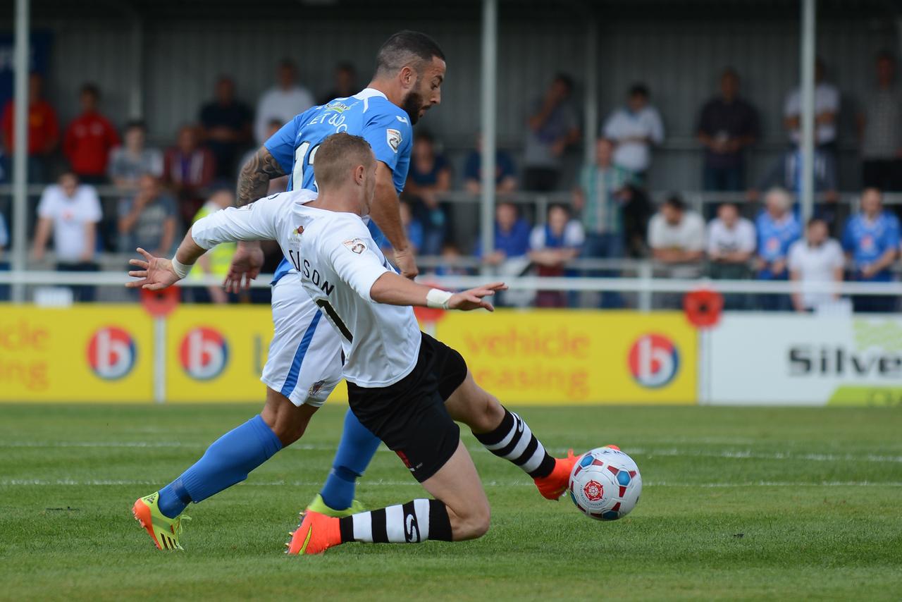 Stuart Fleetwood is beaten by Marcus Maddison