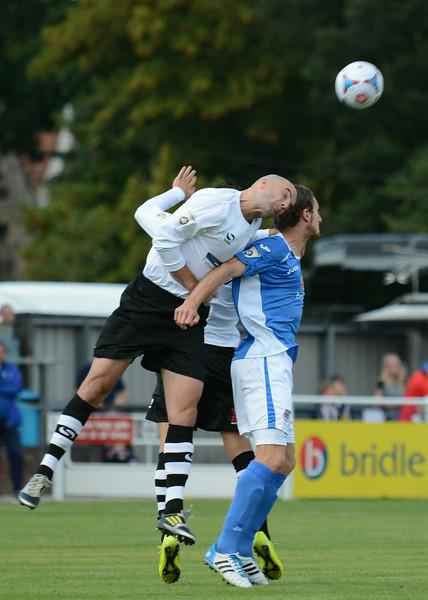 Ben Clark of Gateshead beats Jack Midson in the air