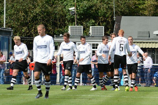 Gateshead players celebrate the opening goal after Dean Beckwith had headed into his own net