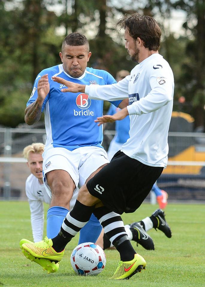 Gateshead's Ryan Wilson challenges Jai Reason