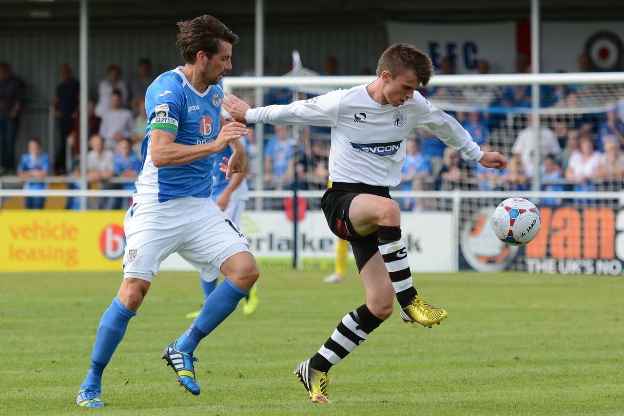 Gateshead's JJ O'Donnell under pressure from Eastleigh's Ben Strevens