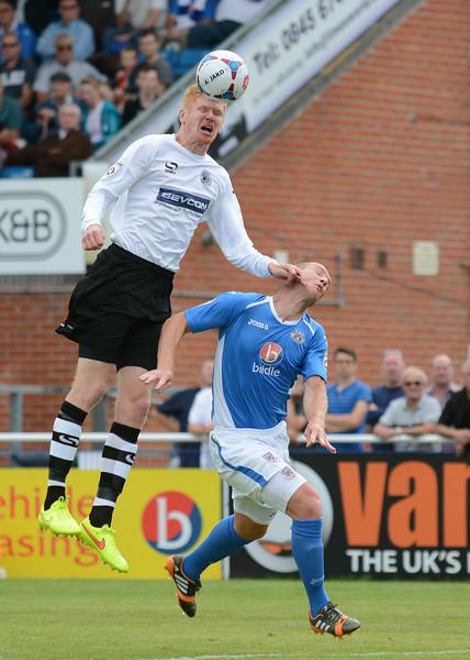 James Curtis beats James Constable to the ball