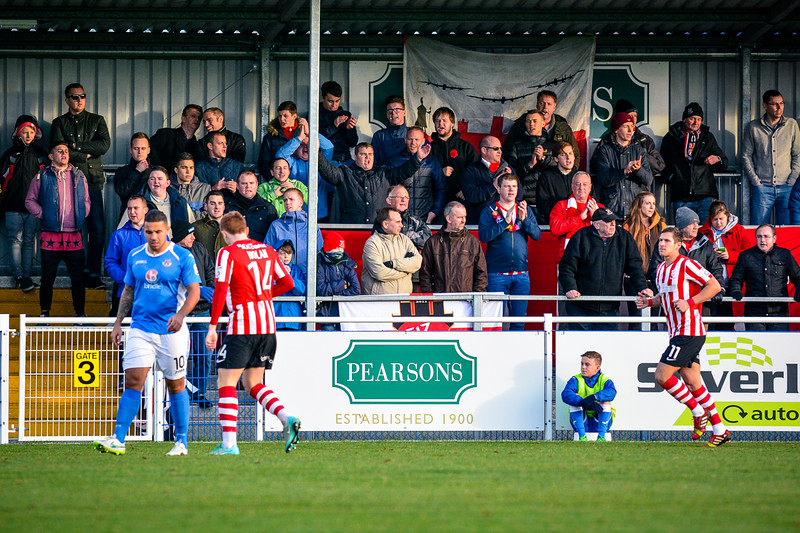 Lincoln City supporters make some noise  during the Vanarama Conference Premier match between Eastleigh and Lincoln City at the Silverlake Stadium, Eastleigh on January 10th 2015 (photo by Paul Paxford/Pitchside Photo)