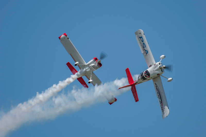 Redline pilots thrill the crowd at the 2017 Vectren Dayton Air Show. The opposing, inverted and formation maneuvers are a crowd pleaser. Ken and Jon both reside in Cincinnati and keep their airplanes in adjoining hangars. They have been flying formation together for more than 10 years.