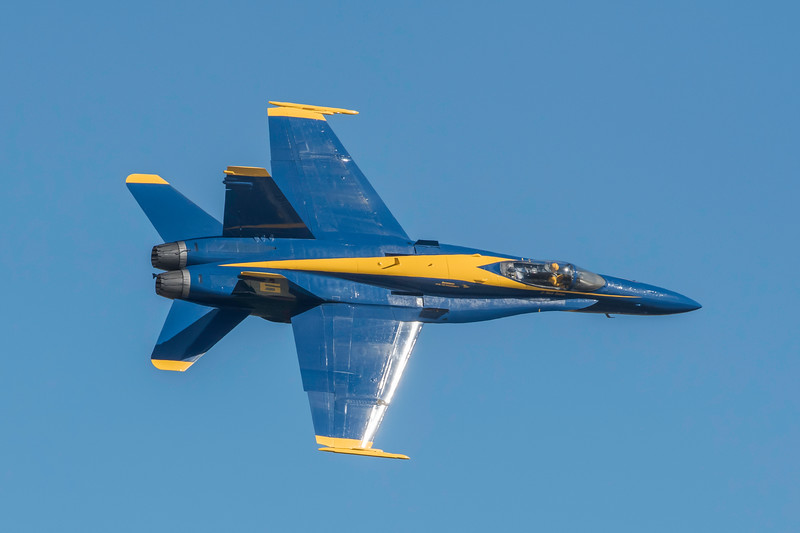 US Navy Blue Angels Opposing Solo #6 performs low speed maneuvers, showing off the versatility of the F/A-18, at the Wings Over Houston Air Show, November 2014.  Image 2 of 2