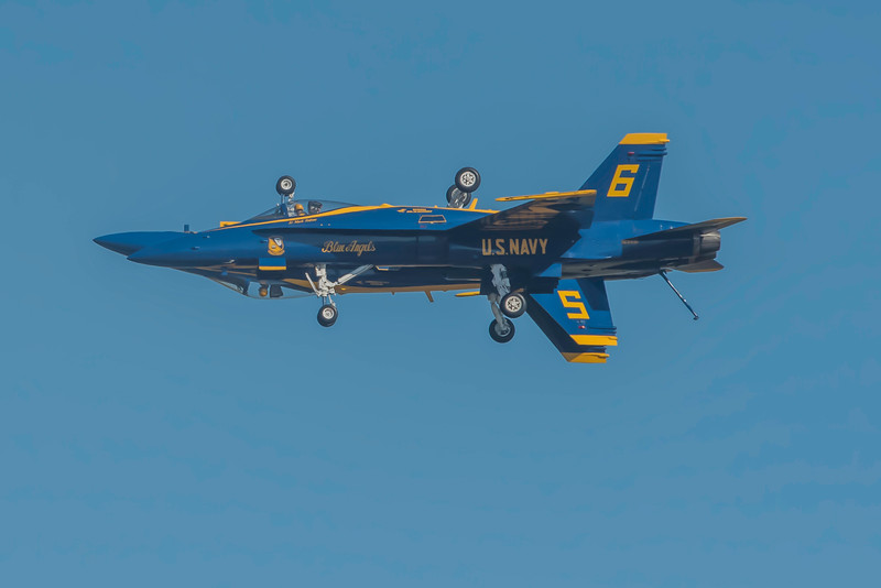 "Iconic capture of the US Navy Blue Angels opposing solos as they perform low speed maneuvers while flying ""dirty"" at the Wings Over Houston Air Show, November 2014."
