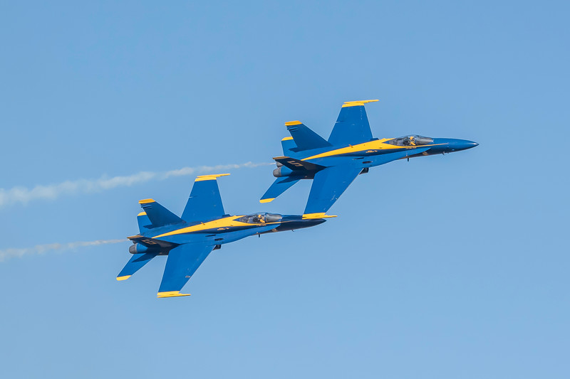 US Navy Blue Angels Opposing Solos #5 and #6 scream past the crowd at the Wings Over Houston, November 2014.