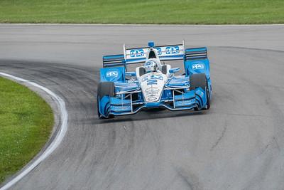 Penske driver Joseph Newgarden negotiates a turn during practice, he will be the race winner.