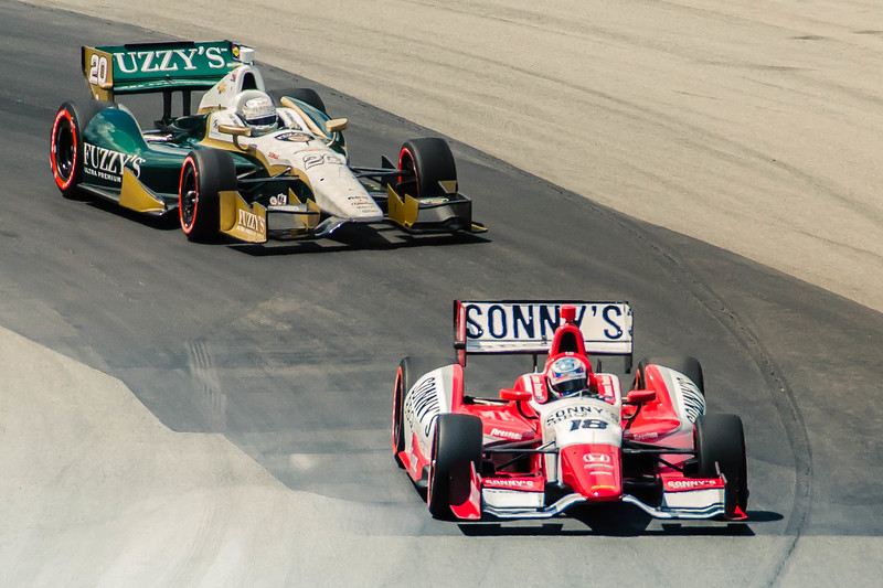 Ed Carpenter reels in the rookie Justin Wilson during practice for the Honda Indy Car 200 at the Mid Ohio Sports Car Complex at Lexington, Ohio.