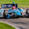 Simon Pagenaud guides the #77 Schmidt Honda through the Esses at the Mid-Ohio Sorts Car Course in Lexington, Ohio; during practice for the 2013 Honda Indy 200.<br /> <br /> Simon finished 2nd