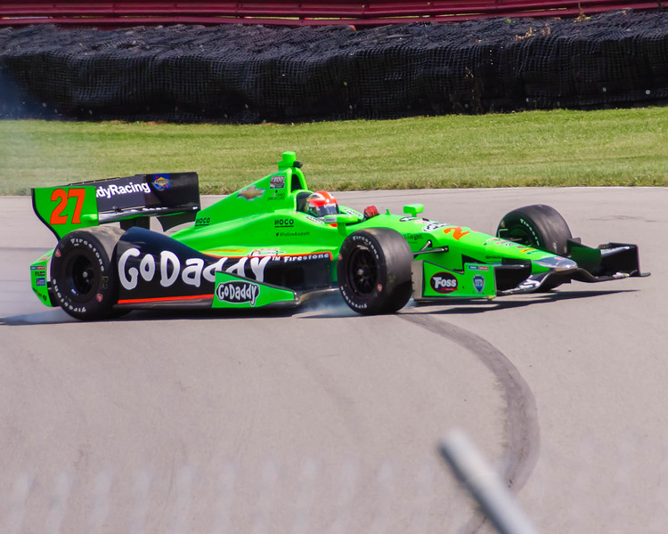 Driver James Hinchcliffe, driving the #27 Go Daddy Andretti Chevrolet loses control entering the Carousel at the Mid Ohio Sports Car Complex during practice for the Honda Indy 200.<br /> <br /> Image 3 of 6 in the crash sequence.<br /> <br /> James finished in 10th place