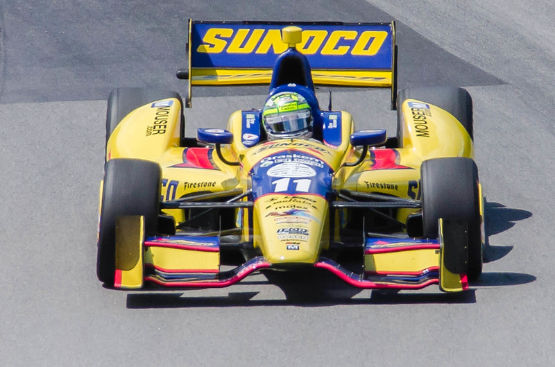 2013 Indy 500 winner Tony Kanaan pilots the  #11 Sunoco Honda through the Esses at the Mid-Ohio Sorts Car Course in Lexington, Ohio; during practice for the 2013 Honda Indy 20<br /> <br /> Tony finished 24th<br /> <br /> Image 2 of 2