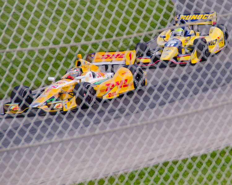 2013 Indy 500 winner Tony Kanaan (#11), chases down Ryan Hunter Reay through the Carousel during a practice session at the Mid-Ohio Sports Car Complex.<br /> <br /> Tony finished 24th