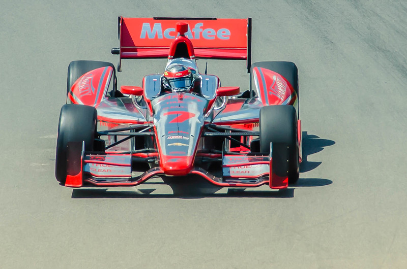 Driver Sebastian Bourdais, driving the #7 McAfee Dragon Chevrolet through the Esses at the Mid Ohio Sports Car Complex during practice for the Honda Indy 200.<br /> <br /> Sebastian finished 12th