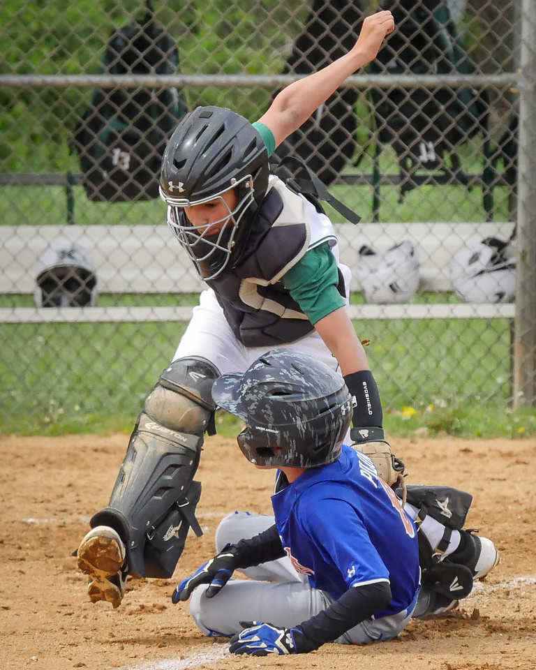 OUT AT HOME PLATE