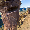 Climbers on the aid pick of the pioneers route, located on Monkey Face at Smith Rock, Oregon