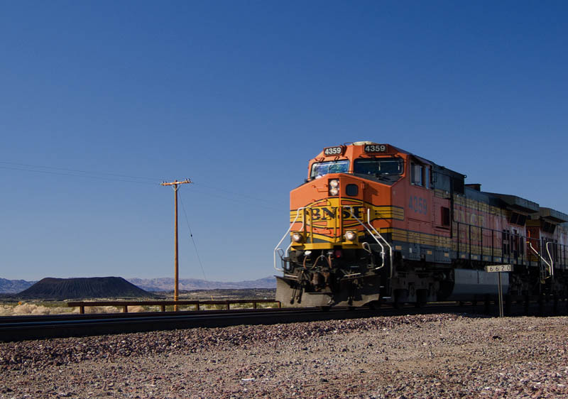 <h3>Fast freight pounds past the Amboy cinder cone at 60-80 mph.