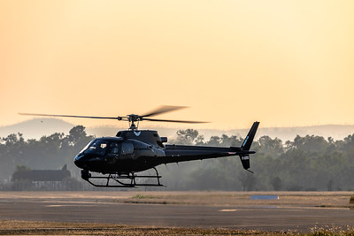 Elite Helicopters Aerospatiale AS.350BA Squirrel VH-WMW 'Firebird 410' landing at Rockhampton Airport 2019-11-13