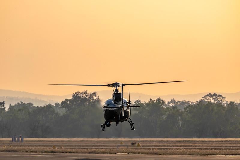 Elite Helicopters Aerospatiale AS.350BA Squirrel VH-WMW 'Firebird 410' landing at Rockhampton Airport 2019-11-13