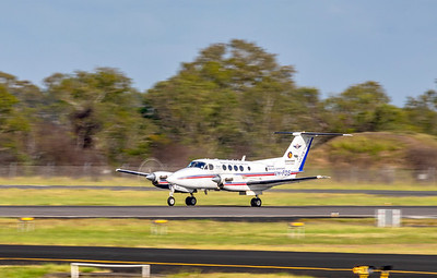 RFDS Beechcraft B200C Super King Air VH-FDS taking off from Rockhampton Airport 25-01-19.