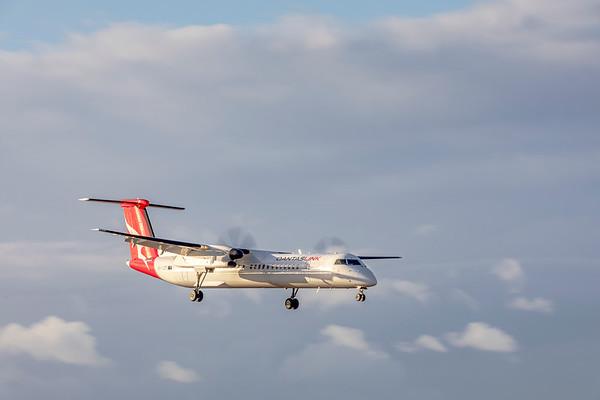 QANTAS De Havilland Dash-8 Q400 VH-LQD landing at Rockhampton airport in new Silver Roo livery 19-05-2019