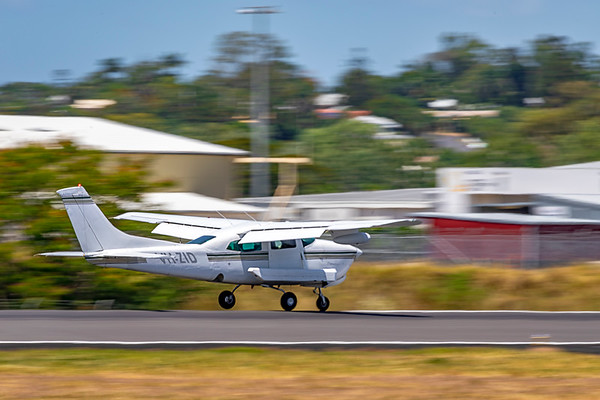Handel Aviation Cessna 210R Centurion VH-ZID landing at Rockhampton Airport after an aerial survey of Rockhampton and Yeppoon 17-02-2019.