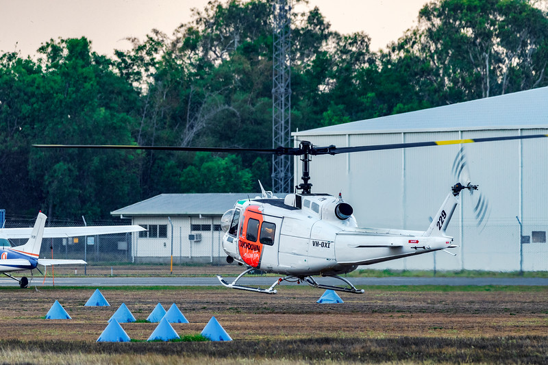 Touchdown Helicopters Bell UH-1H Iriquois VH-OXI landing at Rockhampton Airport